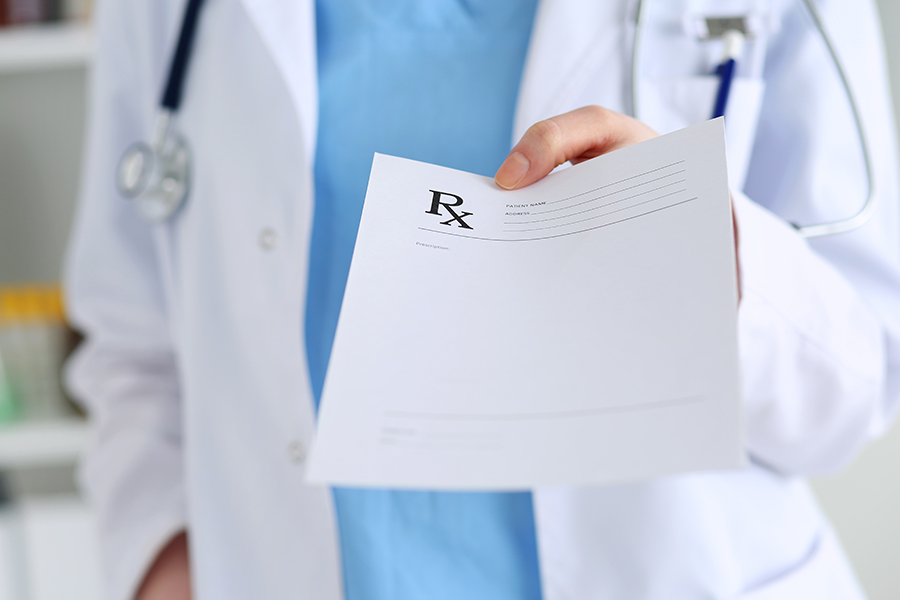 Dispensing Physicians holding a medical paper