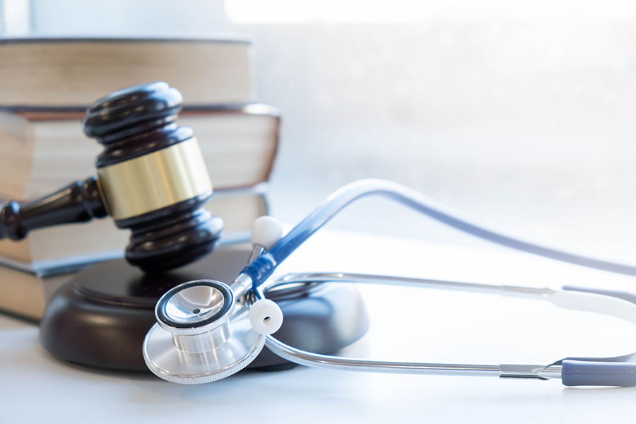 Healthcare Litigation gavel and medical supply