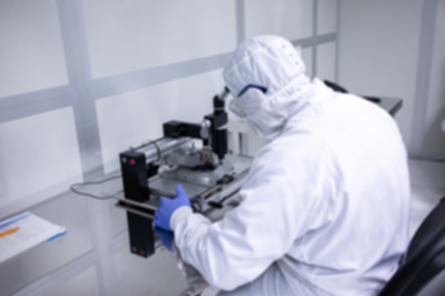 Laboratories doctor looking into microscope