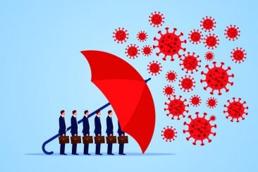 Business people being protected by an umbrella from COVID-19 germs