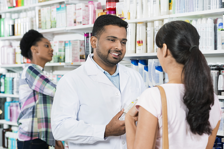 Community, Retail Pharmacist assisting customer