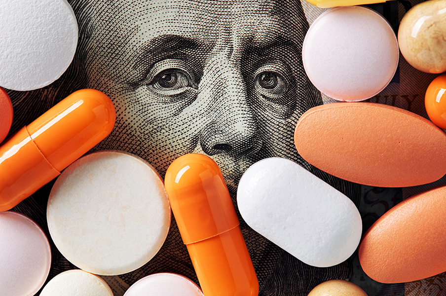 Money with orange and white pills over top