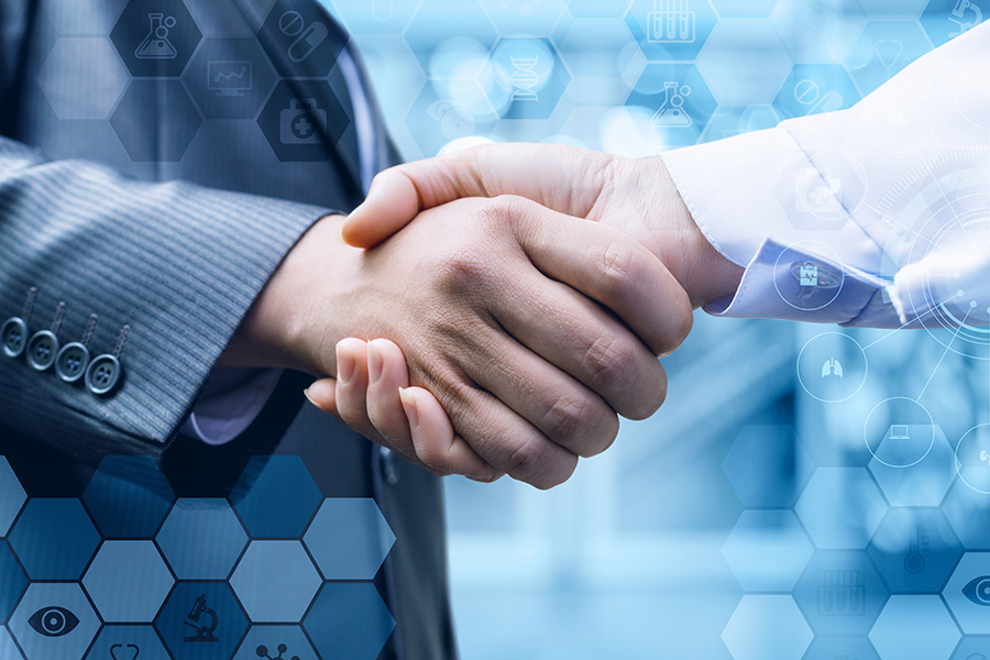 Business negotiation handshake